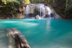 Deep blue stream waterfall in deep forest jungle Stock Photos