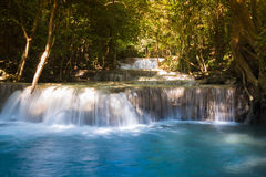 Deep blue stream waterfall in the jungle,natural landscape background Stock Photos