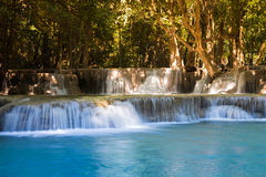 Deep blue stream waterfall Royalty Free Stock Image