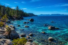 Deep Blue and Turquoise Water at Lake Tahoe. Unique boulders and colorful blue and turquoise water near Chimney Beach, Lake Tahoe, Carson City, Nevada royalty free stock photos