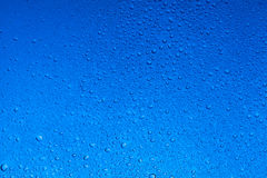Deep blue water drops abstract background royalty free stock image