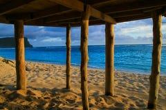 Deep blue waters of Pacific Ocean view through wooden pillars of beach fale - traditional Samoan house Lalomanu beach Samoa. Polynesia royalty free stock photo