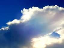 Deep blue, white and pastel coloured clouds