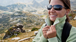 Deep breath in the mountains. Portrait of a smiling female in the mountains Royalty Free Stock Images