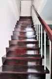 Deep brown hardwood staircase Stock Images