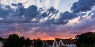 Deep Burning Red Purple Blue Ray Sunset over German Cottages Ulm Stock Images