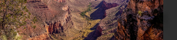Deep canyon of the Grand Canyon. Grand Canyon Village, Arizona. Picturesque panorama. Picturesque panorama of the Grand Canyon in Arizona, USA. Sandstone cliffs stock image
