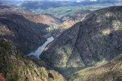 The deep canyon of the Sil River Stock Images
