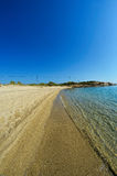 Deep Carydi beach. Sandy beach Deep Carydi, Sithonia, Greece, and electric supply line in background, vertical orientation Royalty Free Stock Images