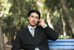 Deep in conversation. A young arabic man deep in conversation on his mobile Royalty Free Stock Images