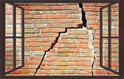 Deep crack on brick wall view from a window Stock Photography