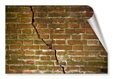 Deep crack in old damaged damp brick wall - concept image with copy space - curl and shadow design concept image.  stock illustration