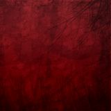 Deep crimson grungy background. With black textures Stock Photos
