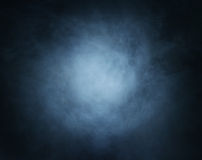 Deep cyan smoke background with light in center Royalty Free Stock Images