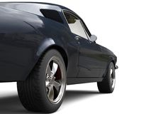 Deep dark blue American vintage muscle car - rear wheel closeup shot Stock Image