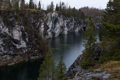 Deep dark lake and the marble canyon during early spring Stock Photography