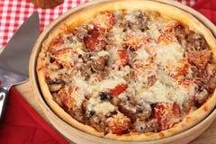 Deep Dish Pan Pizza. With sausage, pepperoni and mushrooms stock photos