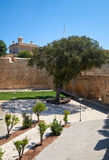 The deep ditch surrounded De Redin Bastion - a part of the forti. The view of defensive walls surrounded the old capital Mdina along the deep ditch of De Redin Stock Photos