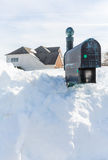 Deep drifts bury mailbox of modern home Royalty Free Stock Images