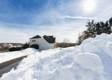 Deep drifts by side of driveway to modern home Stock Images