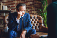 Deep emotions of middle aged businessman Royalty Free Stock Photography