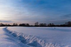 Deep footprints among eternal snow stock image