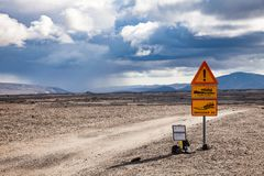 Warning roadsigns at Odadahraun lava field in Highlands of Iceland Scandinavia. Deep ford and rough gravel road warning roadsign and Road F26 closed due to snow stock image