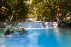 Deep forest blue stream waterfall Royalty Free Stock Images