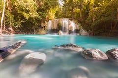 Deep forest blue stream waterfall Stock Photos