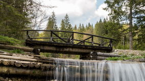 Deep in the forest, time lapse, forest scene - small wood bridge over creek Stock Photography