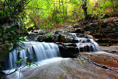 Deep forest Waterfall. With small creek Royalty Free Stock Photography