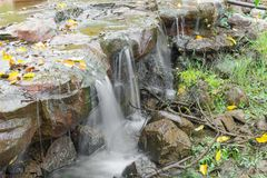 Deep forest Waterfall, Beautiful of with soft flowing water Royalty Free Stock Photography