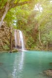 Deep forest waterfall with clear water in erawan national park kanchanaburi stock photo