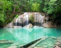 Deep forest waterfall at Erawan waterfall National Park Kanjanab. Uri Thailand Royalty Free Stock Image