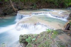 Deep forest waterfall at Erawan waterfall Stock Photo