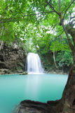 Deep forest waterfall at Erawan waterfall Royalty Free Stock Photography
