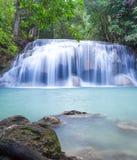 Deep forest waterfall at Erawan waterfall Stock Photos