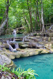 Deep forest waterfall (Erawan Waterfall) in Thailand Stock Photos