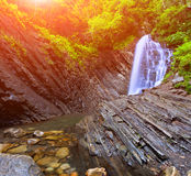 Deep forest waterfall in mountain Stock Photos
