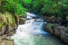 Deep forest waterfall at Nang Rong Waterfall in Nakornnayok, Tha Stock Image