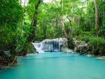 Deep forest waterfall in Thailand Erawan Waterfall royalty free stock images