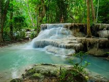 Deep forest waterfall in Thailand Erawan Waterfall stock images