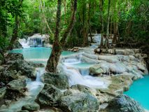 Deep forest waterfall in Thailand Erawan Waterfall stock photography