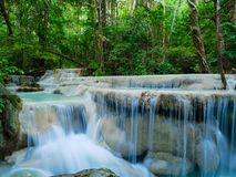 Deep forest waterfall in Thailand Erawan Waterfall stock photo