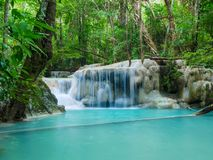 Deep forest waterfall in Thailand Erawan Waterfall stock image