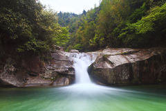 Deep forest waterfall in Wuyuan, China. Royalty Free Stock Photo