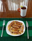 Deep fried bananas with scrambled eggs on white plate Stock Photography