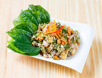 Deep fried barramundi with spicy salad Royalty Free Stock Photo
