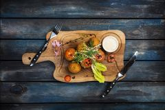 Deep fried beef meat balls in breadcrumbs with cheese sauce royalty free stock photos