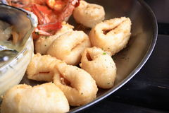 Deep fried calamari. A plate of deep fried calamari stock photo
